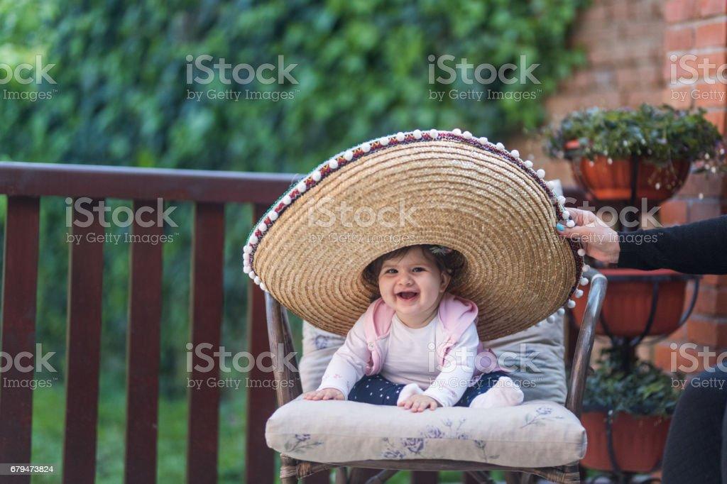 搞笑小寶貝小姐與草帽 免版稅 stock photo