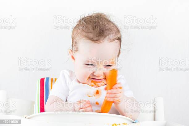 Funny little baby trying vegetable for the first time picture id470446081?b=1&k=6&m=470446081&s=612x612&h=hinw7yaf0aypj5k5syoq1l82mvwqacy2m6h3 ydwv8u=