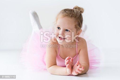 istock Funny little ballerina in pink tutu 518882110