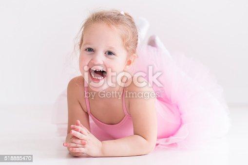 istock Funny little ballerina in pink tutu 518885470
