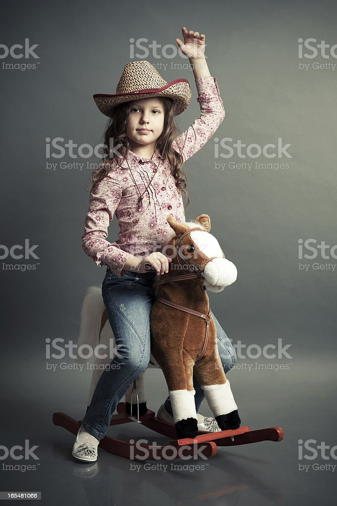 Funny little cowgirl royalty-free stock photo