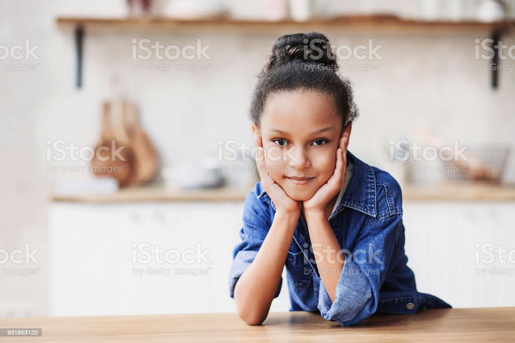 Funny little girl at home stock photo