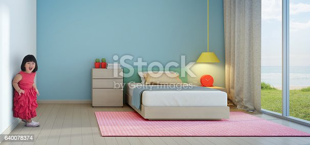 istock Funny little girl in kids room of modern beach house 640078374