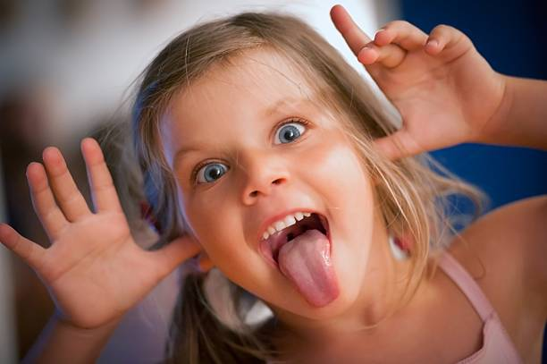 funny little girl - tongue stock photos and pictures