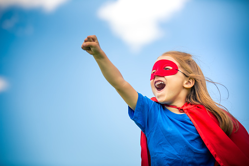 istock Funny little girl playing power super hero. 658145352