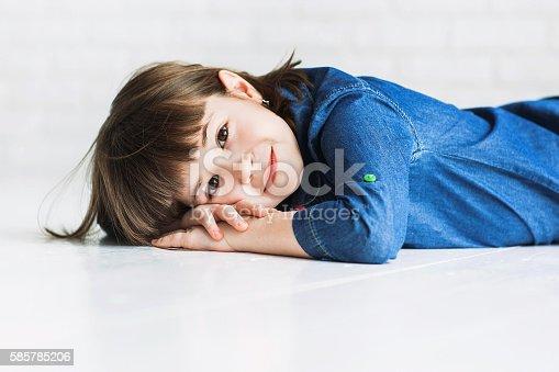 istock Funny little girl portrait 585785206