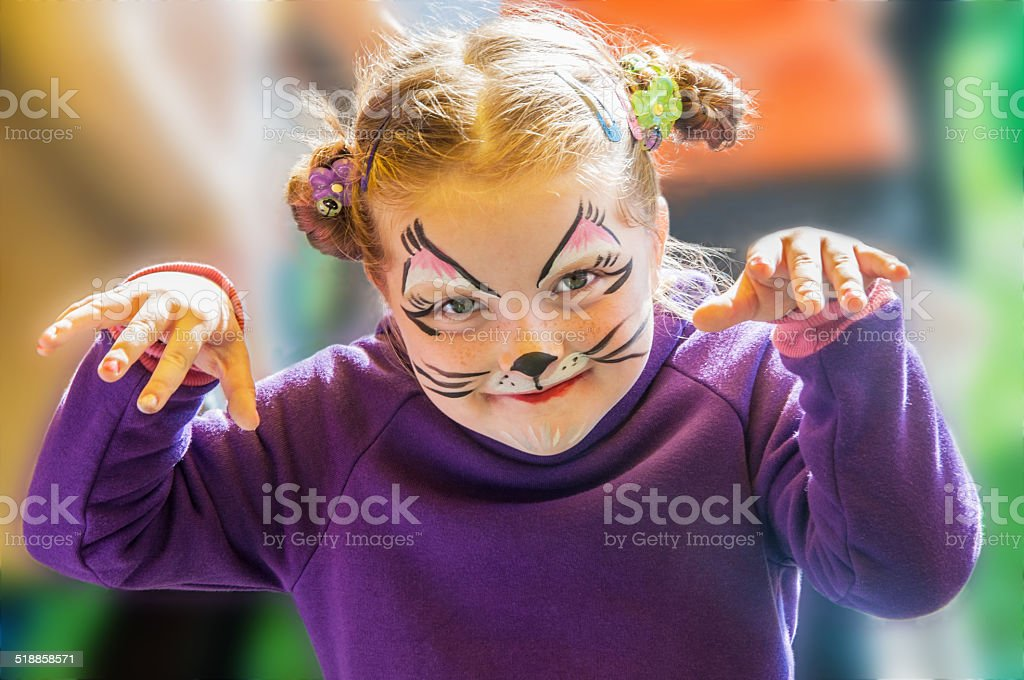 Funny little girl with painted face stock photo