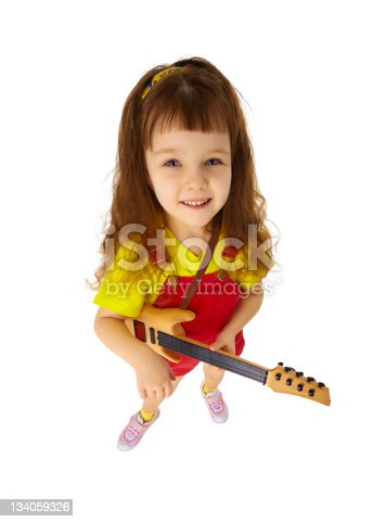 849362192istockphoto Funny little girl with toy guitar on white 134059326
