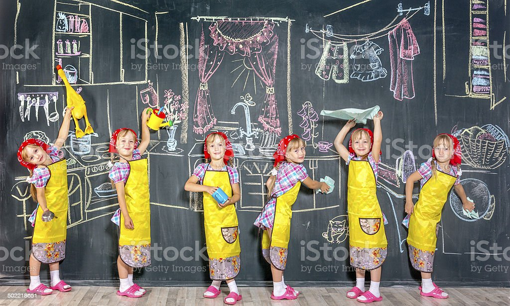 Funny little homemakers stock photo