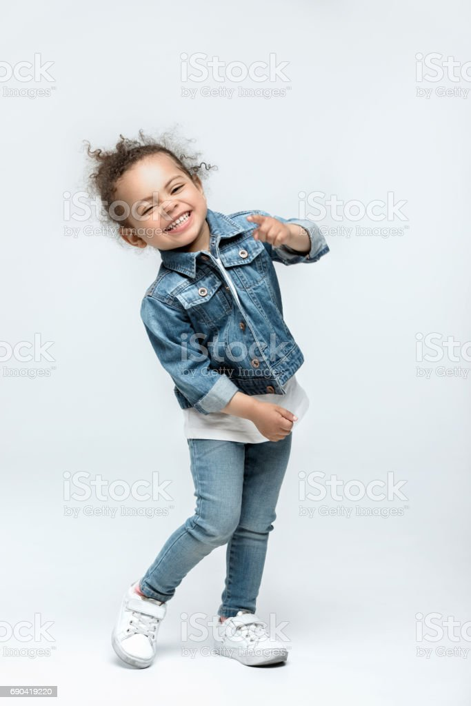 funny little kid girl in jeans isolated on white royalty-free stock photo