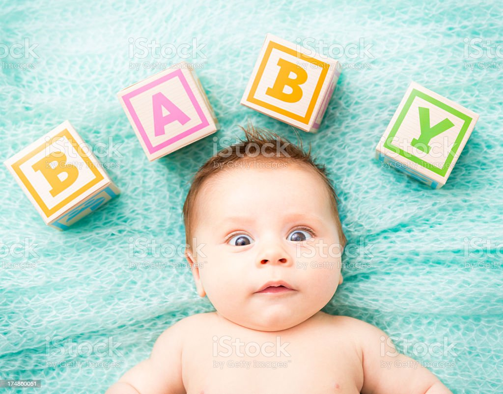 Funny looking Baby Lying On blanket stock photo