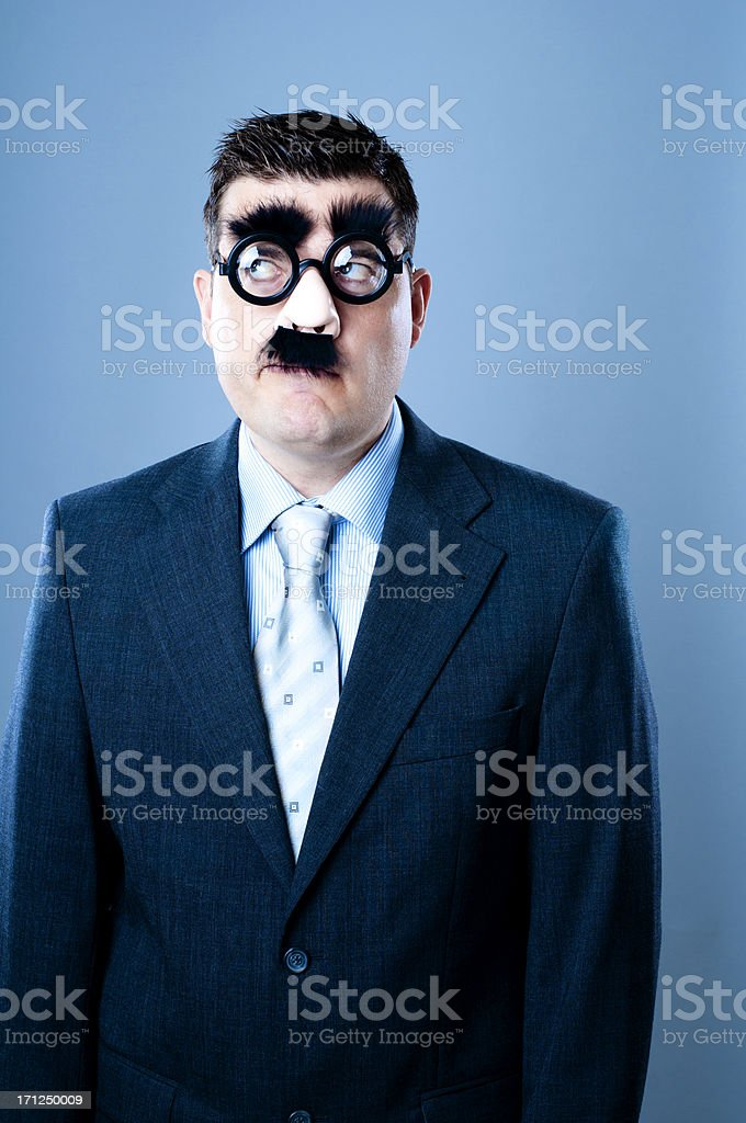 Funny looking businessman is thinking about something stock photo
