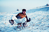 Funny Male Experiencing Sledding Adrenaline