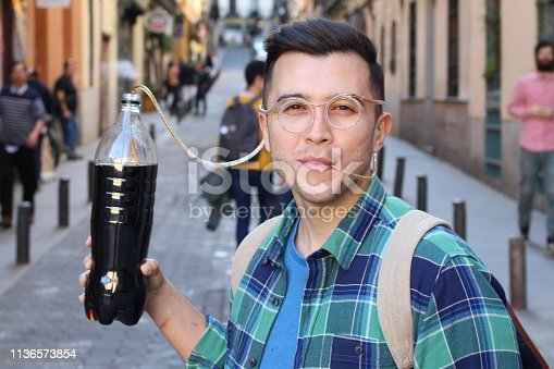 1067846662 istock photo Funny man addicted to soda 1136573854