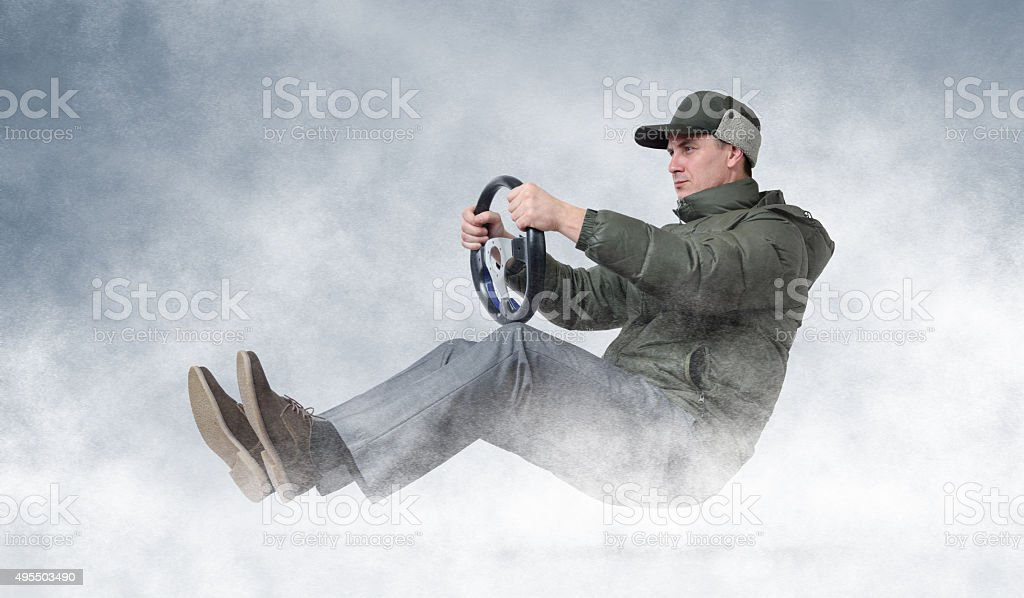 Funny man driving a car in winter, winter driving concept stock photo