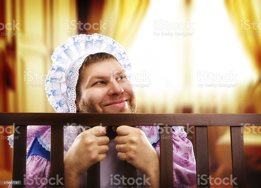 Funny man in playpen looking out stock photo
