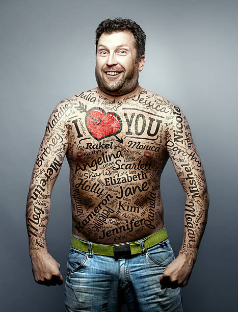 funny man make declaration of love to all woman - tattoo stock photos and pictures