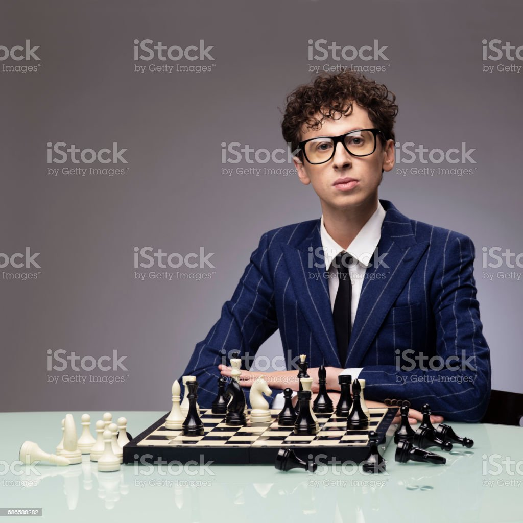 Funny man playing chess royalty-free stock photo