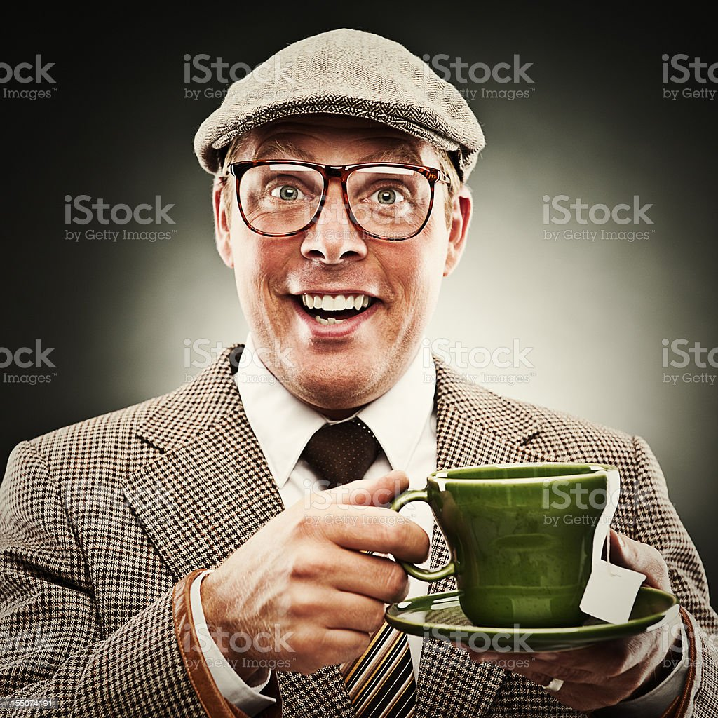 Funny man smiling with tea wearing porkpie hat stock photo