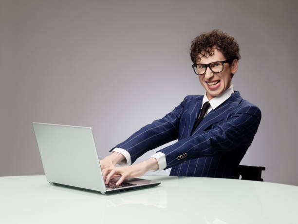 funny man using laptop - nerd stock photos and pictures