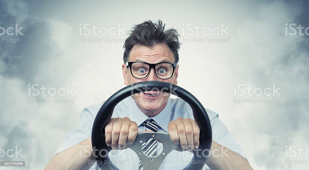 Funny man with a steering wheel in smoke stock photo