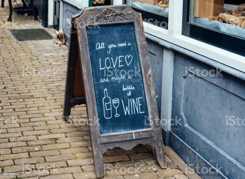 Funny message handwritten with chalk in the slate of a wine bar stock photo