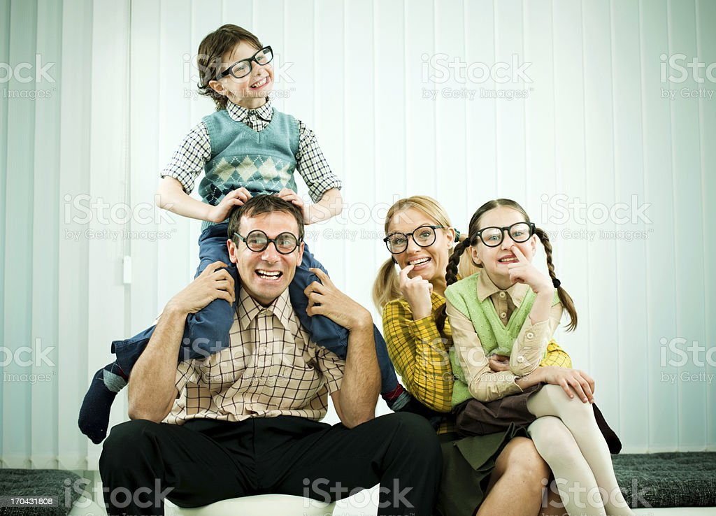 Funny  nerd family looking at the camera. royalty-free stock photo