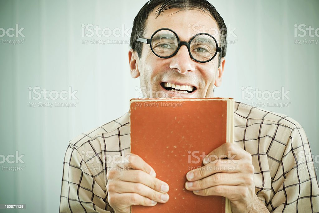 Funny nerd holding an orange book. royalty-free stock photo