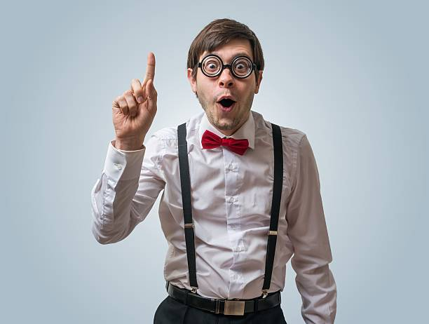 Funny nerd or geek have an idea. Funny nerd or geek have an idea and holds finger up. nerd stock pictures, royalty-free photos & images