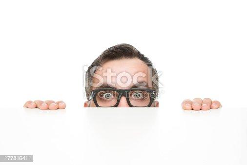 istock Funny nerd peeking 177816411