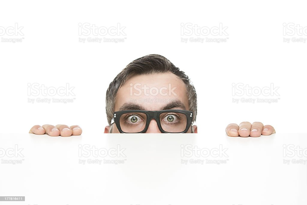 Funny nerd peeking stock photo