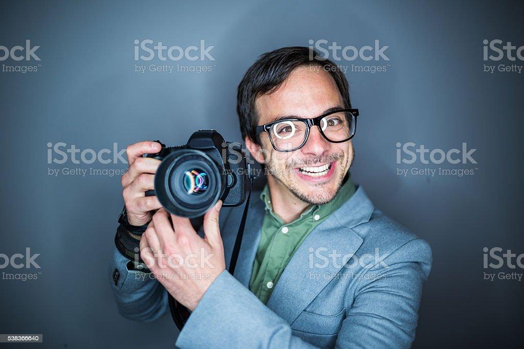 Funny nerd photographer stock photo