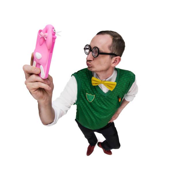 Funny nerd taking selfie stock photo