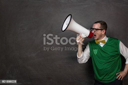 istock Funny nerd yelling at the megaphone 601896028