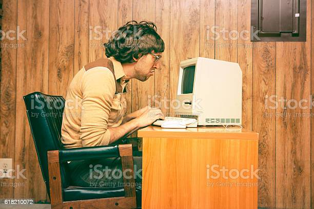 Funny nerdy man looking intensely at vintage computer picture id618210072?b=1&k=6&m=618210072&s=612x612&h=hyxzmpaifr2z9c ersbkwlyegkh4i5buh mhoj fz0a=