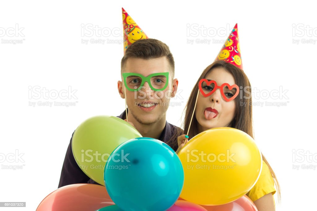 funny nice guy with a girl in glasses and keep their balloons close-up stock photo