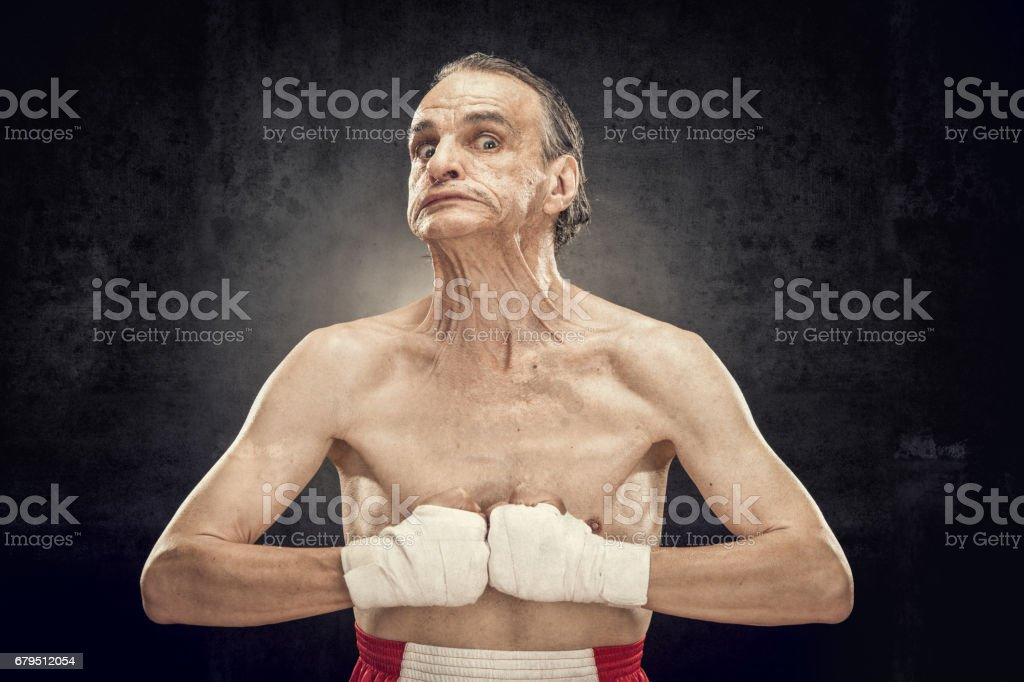 funny old boxer portrait show muscle isolted on black royalty-free stock photo