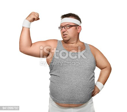 526668973 istock photo Funny overweight man showing muscle 941399732