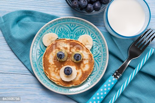 istock Funny pancake in a shape of teddy bear, food for kids idea, top view 642505756