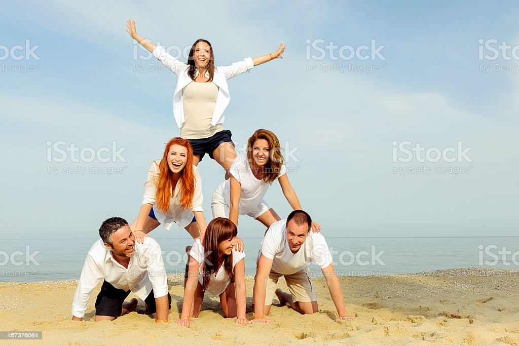 funny people pyramid stock photo
