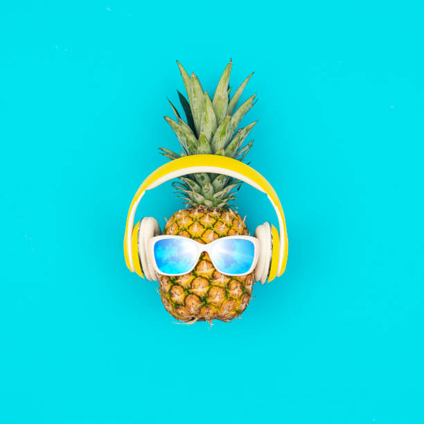 Funny pineapple with sunglasses stock photo