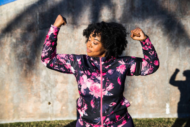 Funny portrait of a young black curvy woman during a training session Funny portrait of a young black curvy woman during a training session body positive stock pictures, royalty-free photos & images
