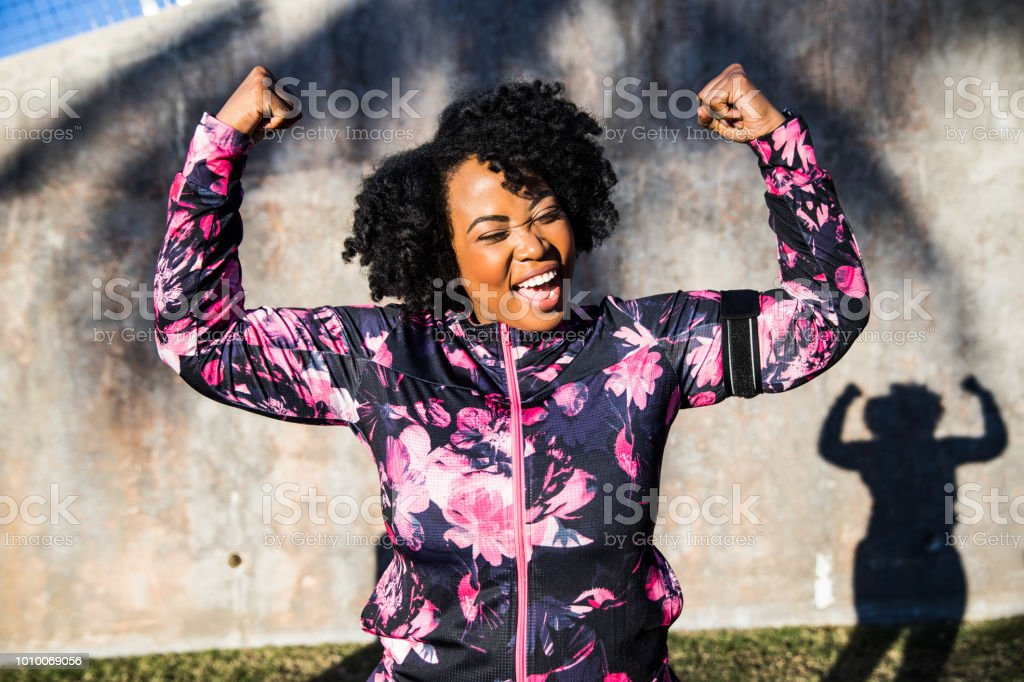 Funny portrait of a young black curvy woman during a training session stock photo
