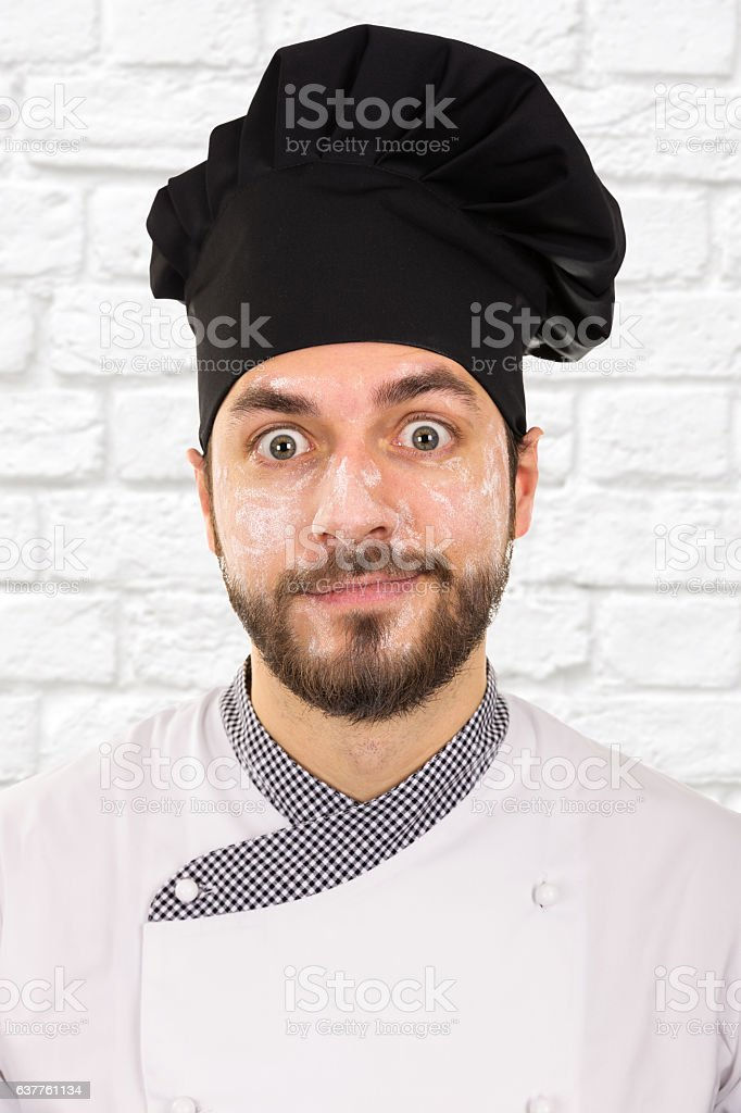 funny portrait of chef with flour on face - Photo