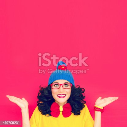 istock Funny portrait of girl against bright pink background 459709231