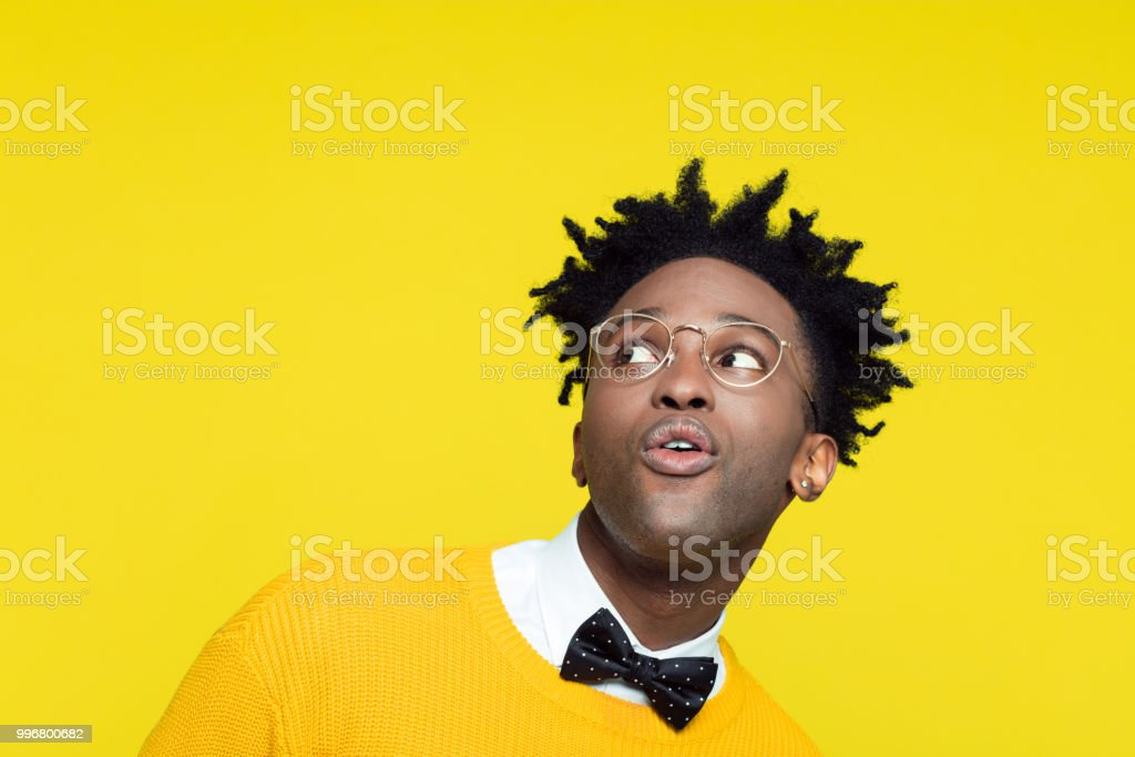 Funny portrait of surprised nerdy young man looking up stock photo