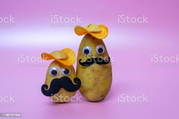 Funny potato head with face on pink background picture id1180197305?b=1&k=6&m=1180197305&s=612x612&h=tsgmch6ymf7h65h2008ne38rwrqpbeztefoslhqh ro=
