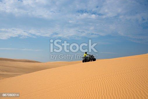 istock ATV funny racing on White sand dune in Mui-Ne city, Vietnam. 667060014