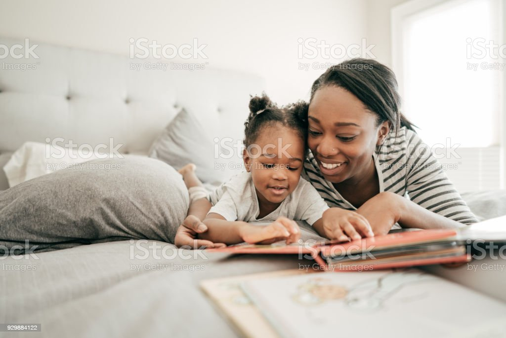 Funny reading stories for toddler stock photo