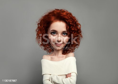 istock Funny red curly girl with big head and funny hairstyle. Caricature stylization of female logic 1130187667